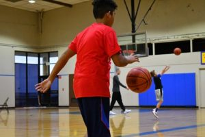 Boy practicing basketball at Next Level 805 Basketball Clinic
